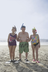 Group of seniors wearing snorkeling gear on the beach