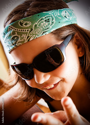Young girl making the peace sign