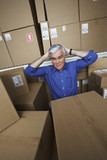 Frustrated businessman in warehouse
