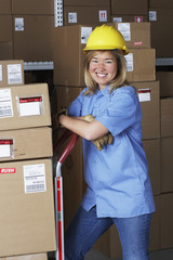 Female warehouse worker with hard hat