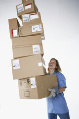 Studio shot of female warehouse worker carrying packages