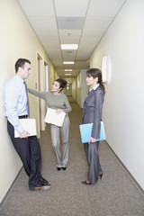 Businesspeople talking in the hallway
