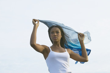Young African woman with shawl blowing in the wind