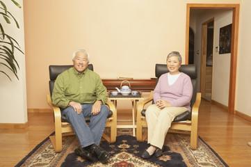 Senior Asian couple having tea