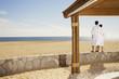 Couple in bathrobes at beach