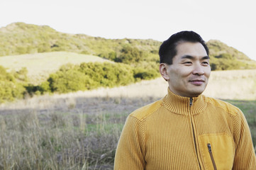 Asian man in the countryside