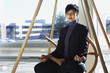 Asian businesswoman meditating
