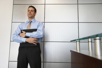 Businessman standing in front of wall