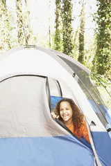 African American girl peeking out of tent