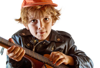 Kid learning to play guitar