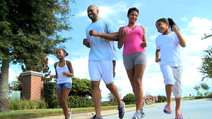 Young Ethnic Family Healthy Jogging