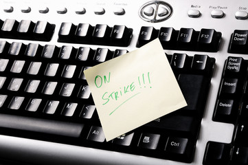 Adhesive Note on keyboard