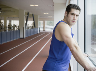 Man next to window of indoor track