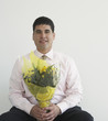Businessman holding bouquet of flowers