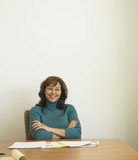 Businesswoman at conference table with paperwork
