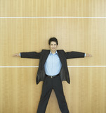 Hispanic businessman standing with arms spread out