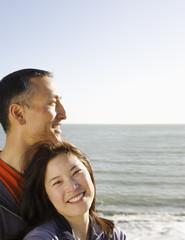 Asian couple on the beach