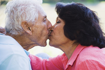 Senior Hispanic couple kissing