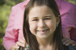 Close up of young Hispanic girl smiling