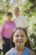 Young Hispanic girl smiling outdoors