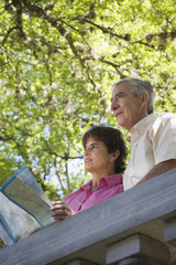 Senior couple with map outdoors