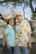 """Senior couple wearing sunglasses, straw hat and Hawaiian shirt"""
