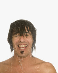 Man laughing in shower