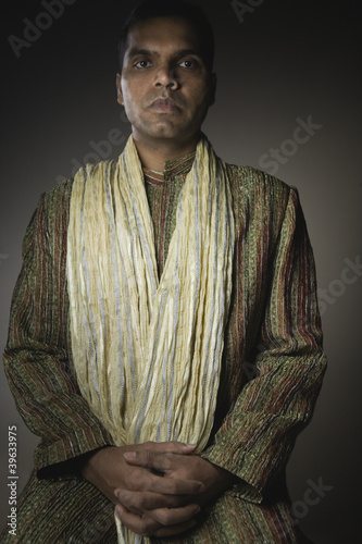 Indian man with hands clasped