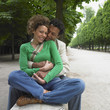 African couple hugging in park