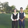 Senior Asian couple on golf course