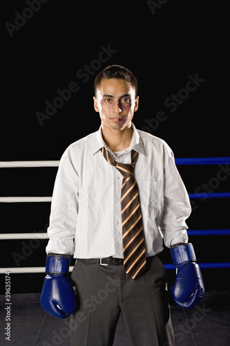 Bruised businessman in boxing ring