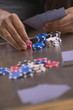 Close up of poker table with man's hands