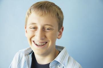 Teenaged boy smiling with braces