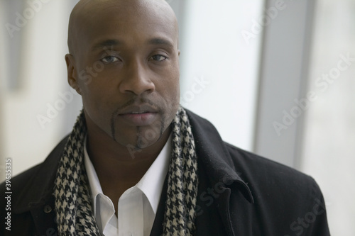 Close up of African man wearing overcoat and scarf
