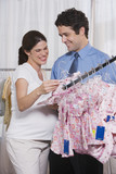 Pregnant Woman and Husband Shopping for Baby Clothes