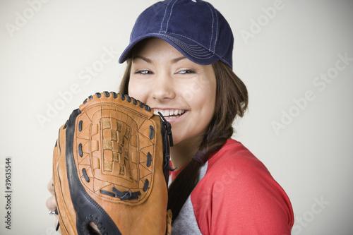 Hispanic woman smiling with baseball glove