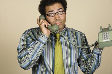 Native American businessman talking on telephone