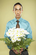 Middle Eastern businessman holding bouquet of flowers