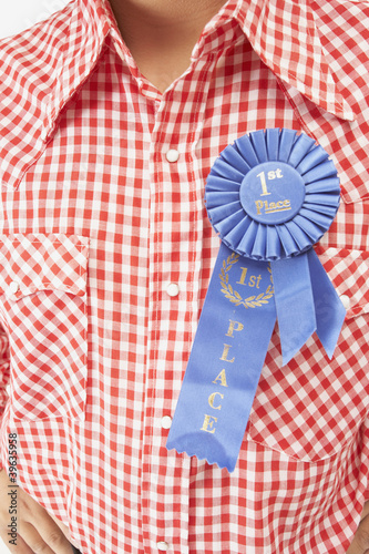 Close up of blue ribbon on man's shirt