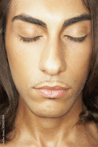 Close up of Middle Eastern man with eyes closed