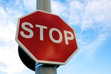 Stop sign against blue sky.