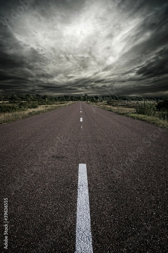 Road and a stormy sky.