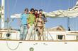 Portrait of multi-ethnic friends on sailboat