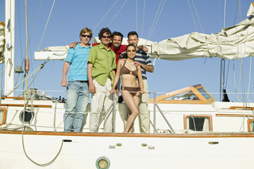 Portrait of multi-ethnic friends on sailboat