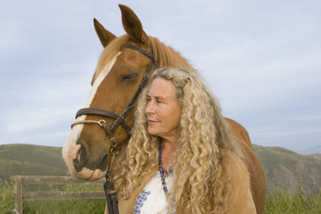 Portrait of senior woman and horse