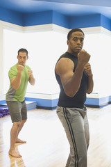 Two men practicing martial arts at health club