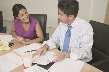 Hispanic businesspeople working at table
