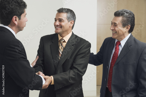 Hispanic businessmen shaking hands