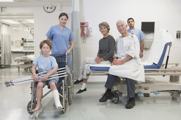 Healthcare professionals and patients posing in hospital setting