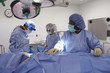 Doctors preparing patient in operating room